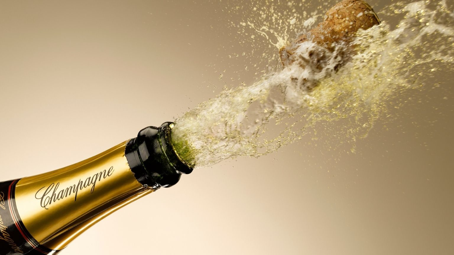 Champagne and cork exploding from bottle