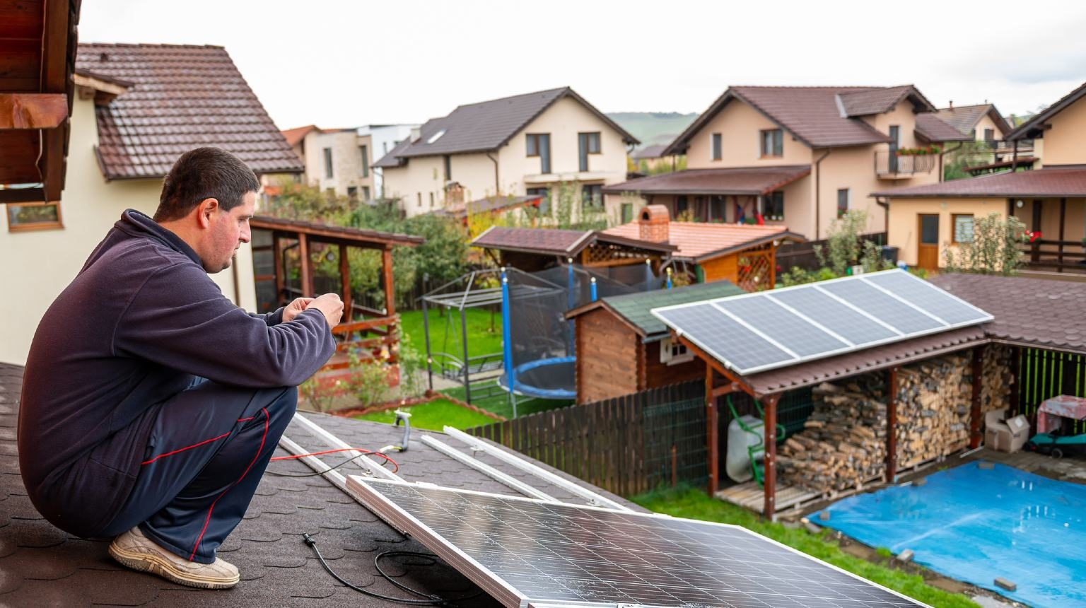 Man installing solar panel on the roof