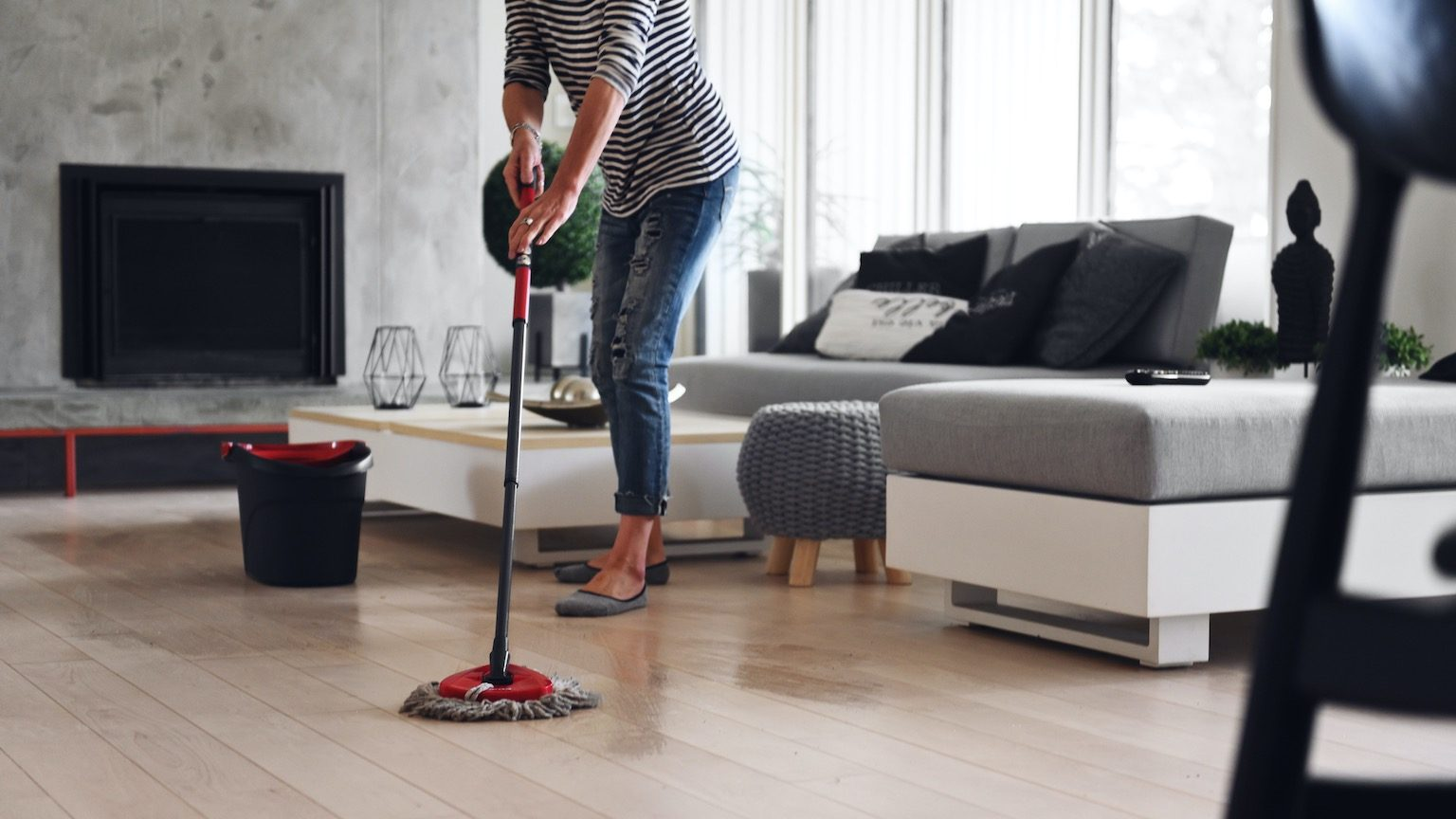 Mature woman cleaning floor while quarantined at home, Quebec, canada