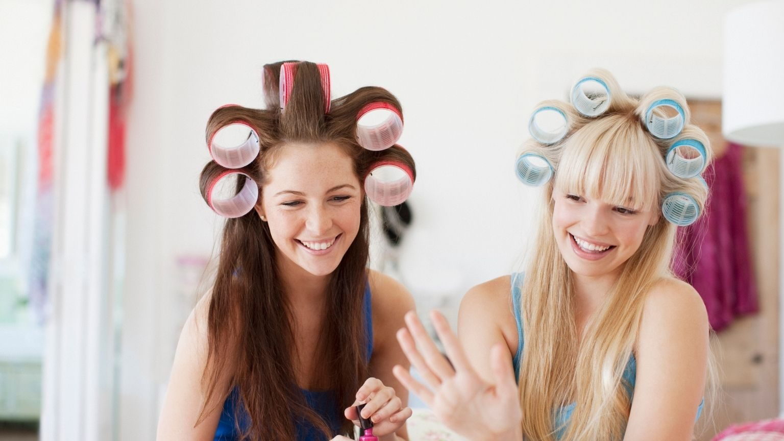 Women with curlers in hair