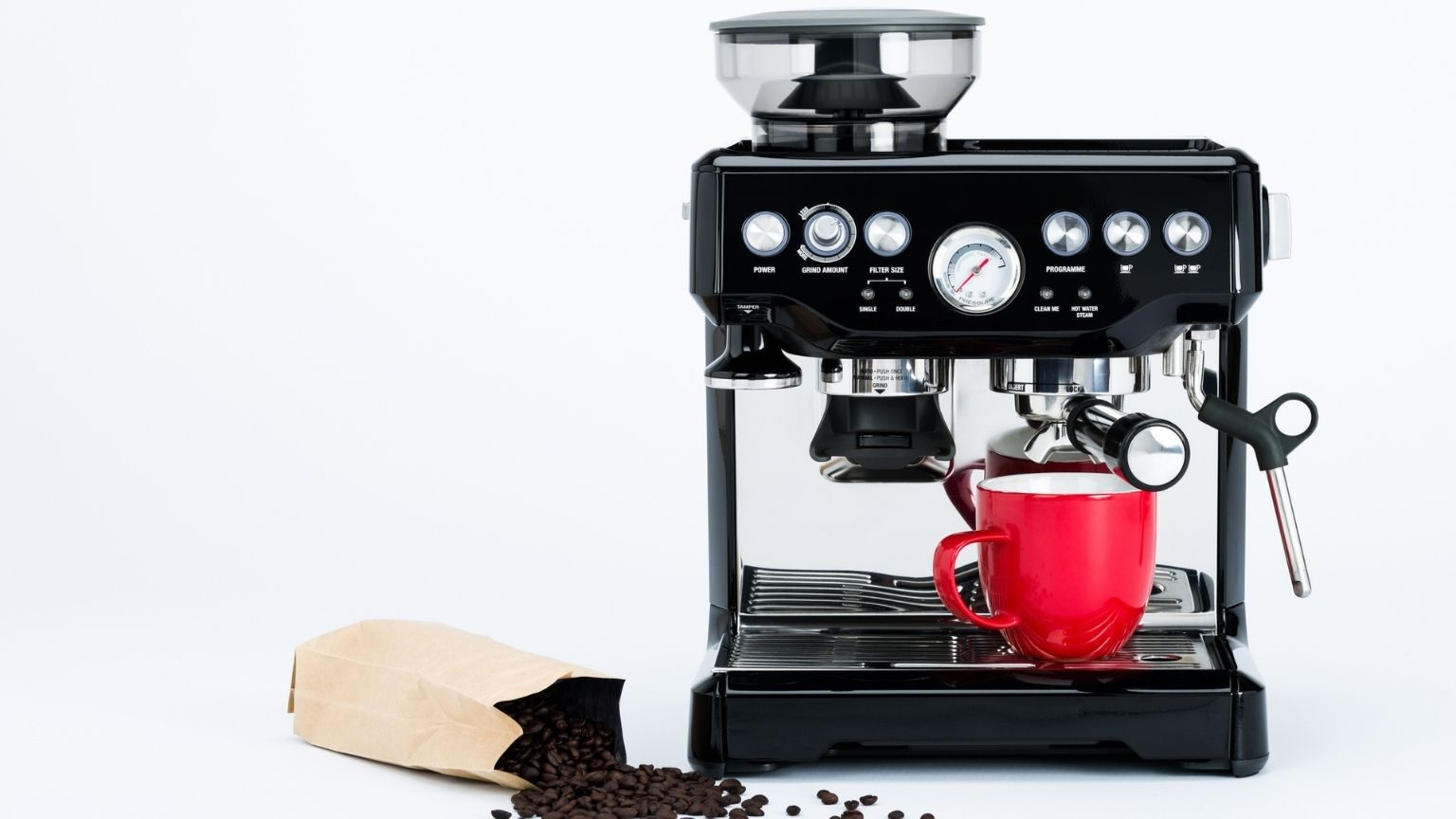 coffee maker with grinder and red coffee mug