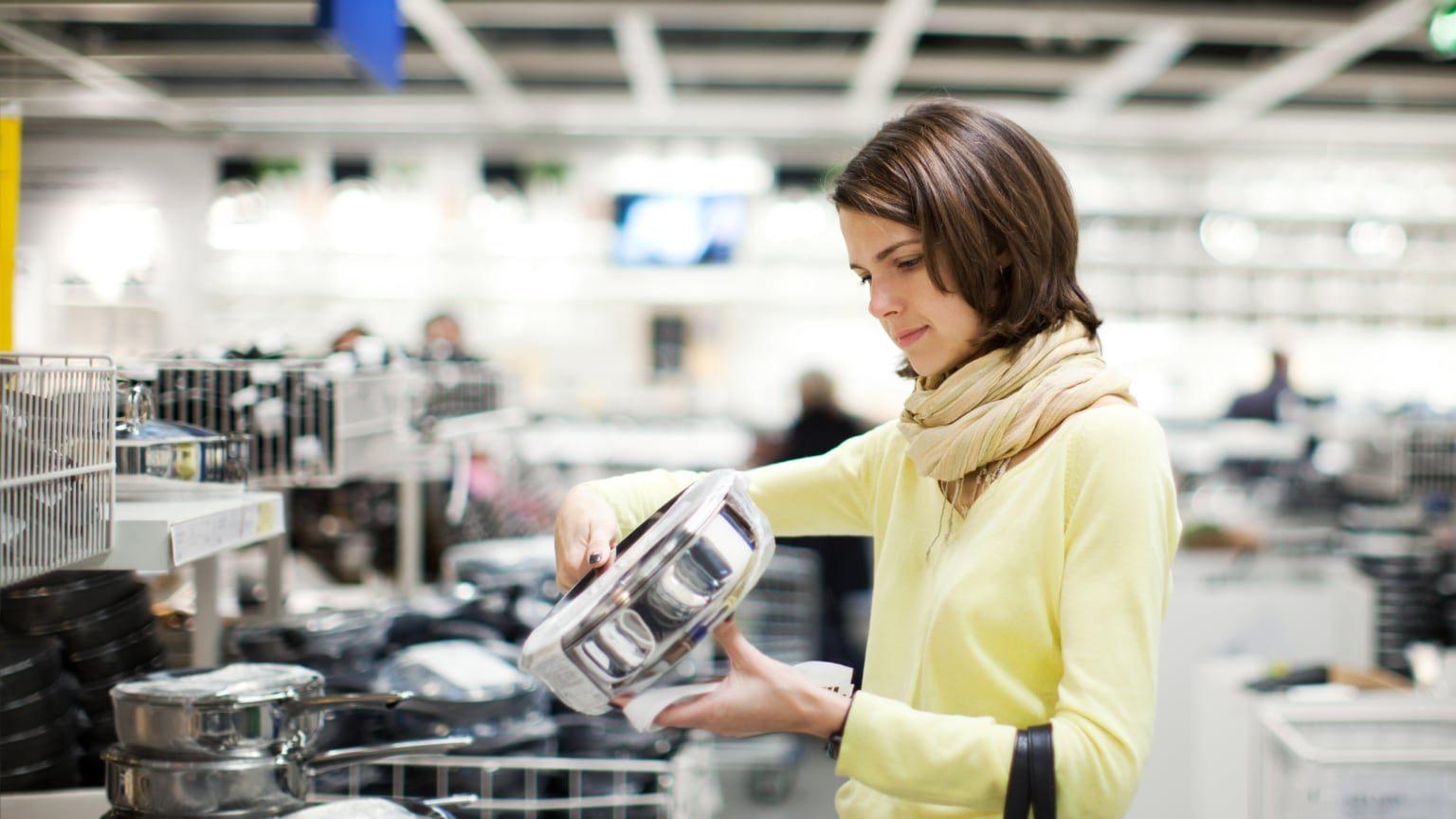 Woman choosing cookware