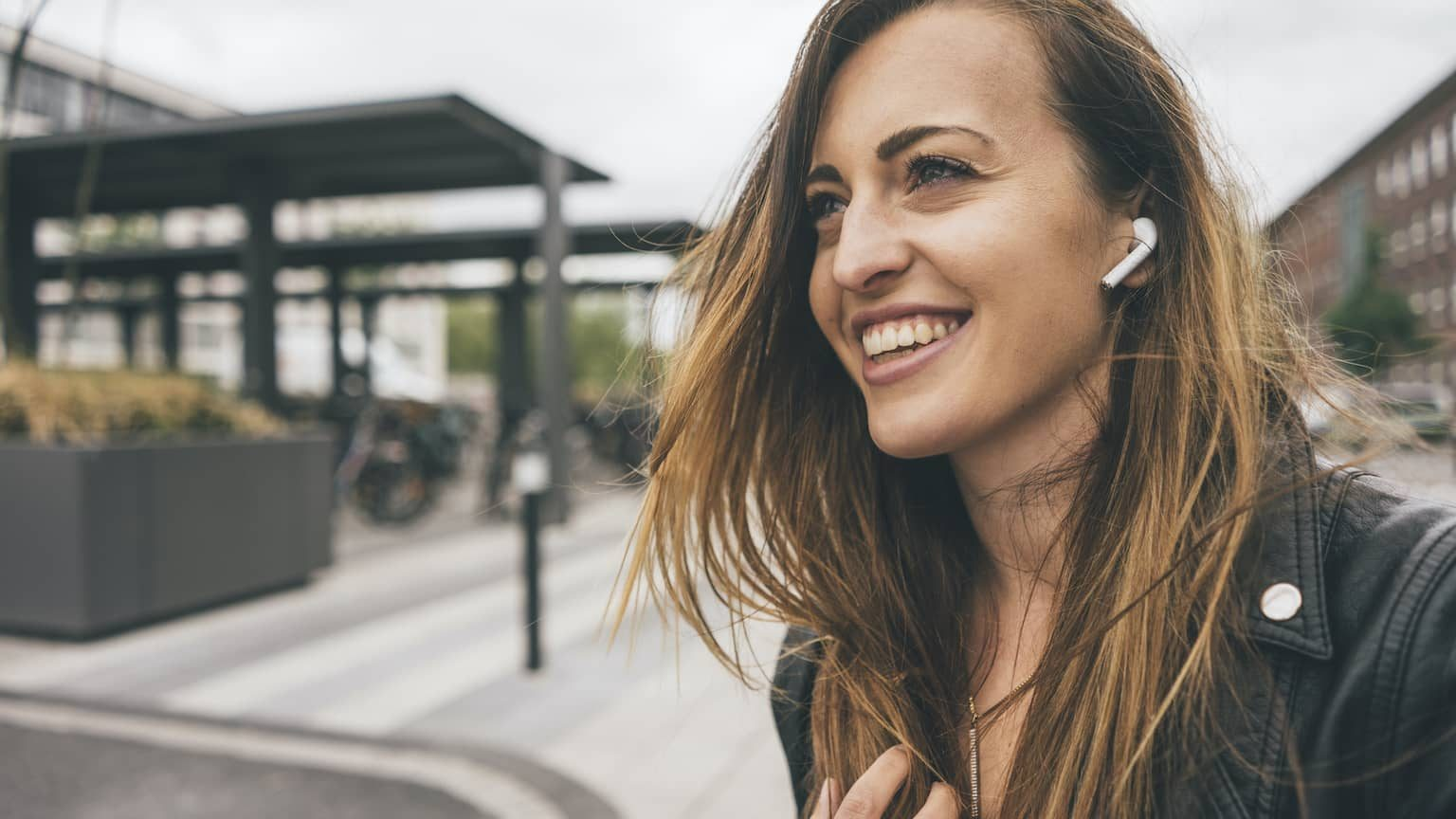Woman wearing Apple Airpods