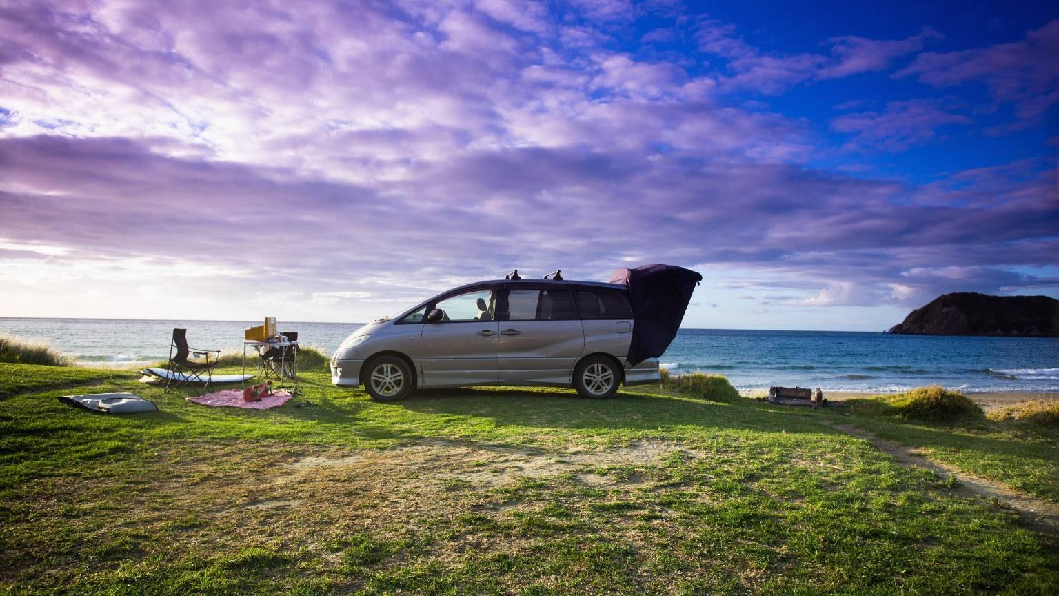 Campervan on beach in New Zealand.