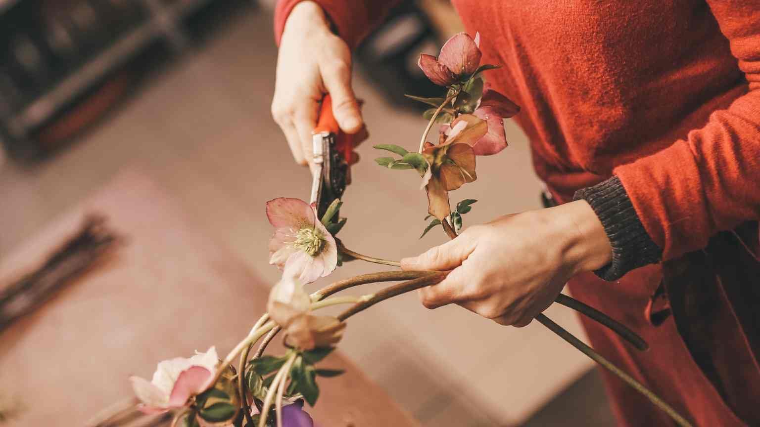 florist cutting flowers with shears