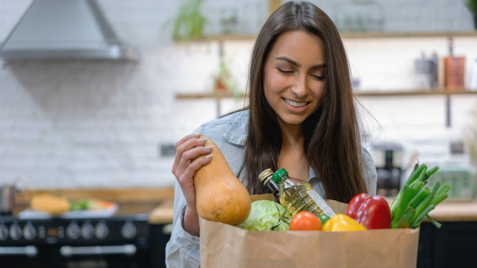 Woman unpacking grocery bag