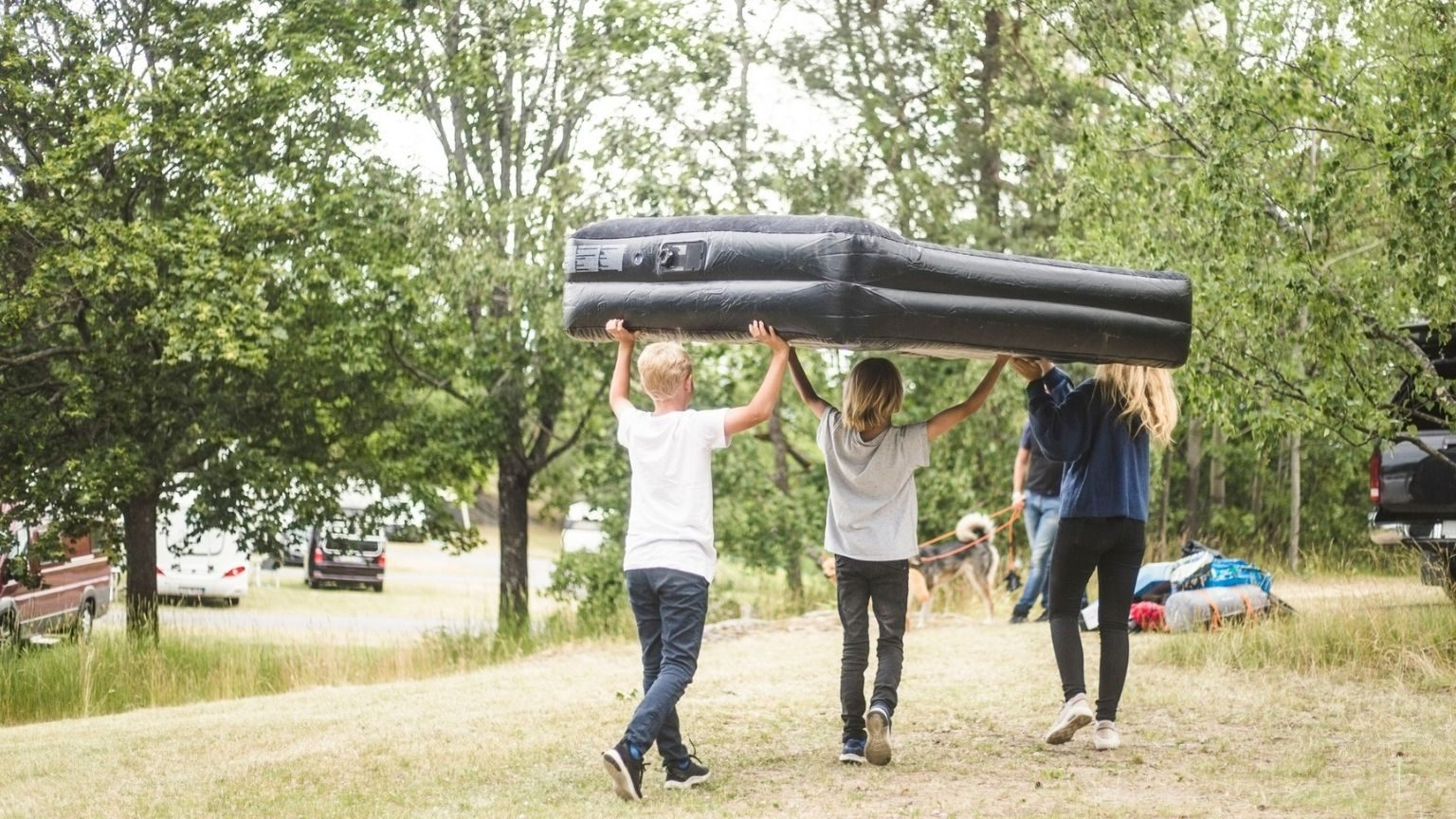 Children carrying inflatable mattres