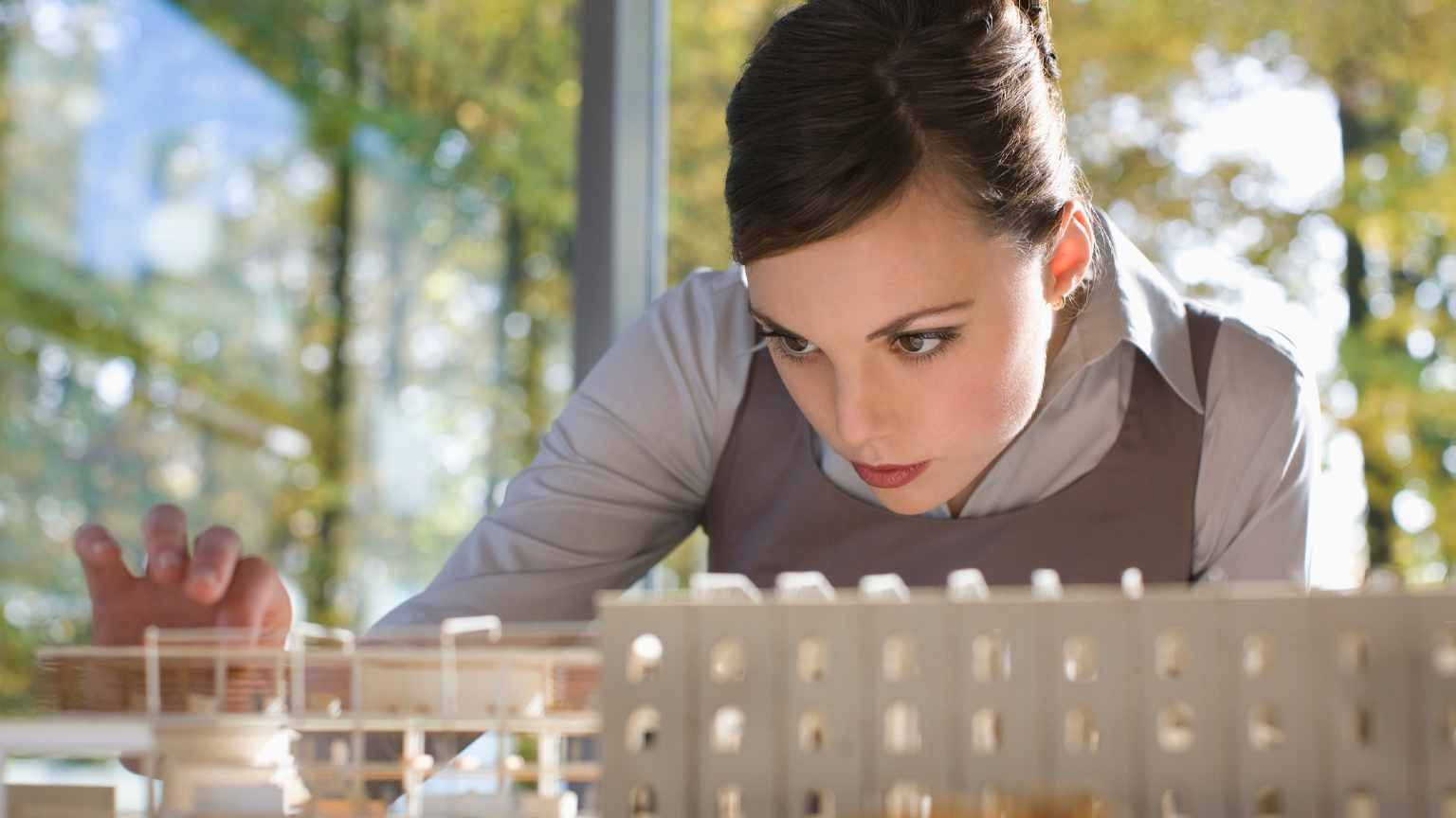 woman looking at an architectural model
