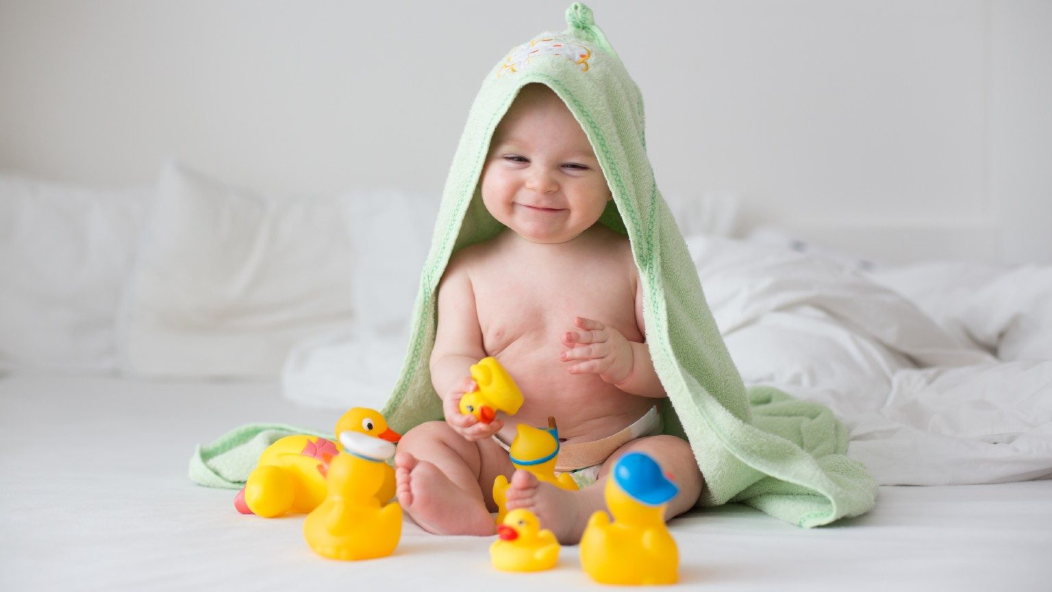 Baby playing with toy ducks
