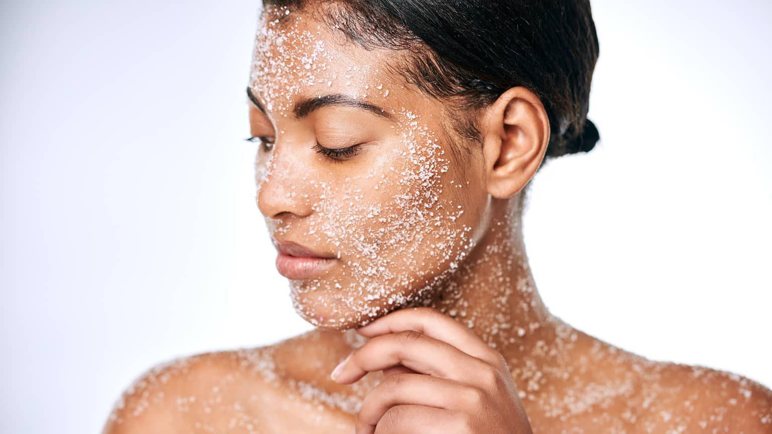 Woman using a sugar scrub