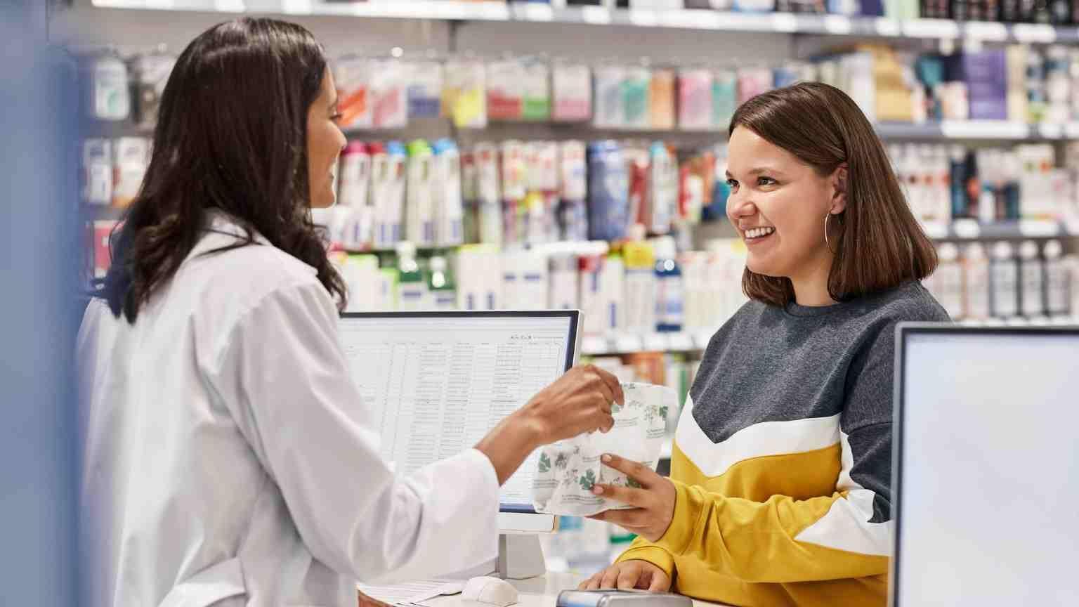 women at a pharmacy