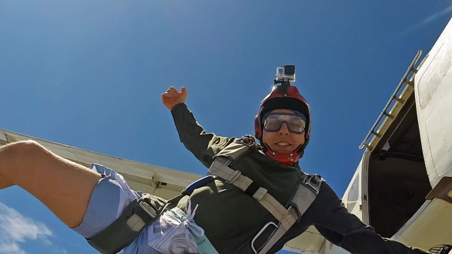 Boy jumping from the plane