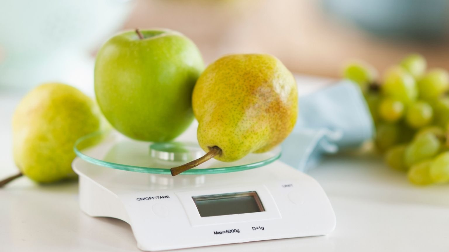 fresh fruits on weight scale