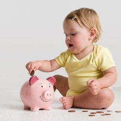Baby saving money in a piggy bank