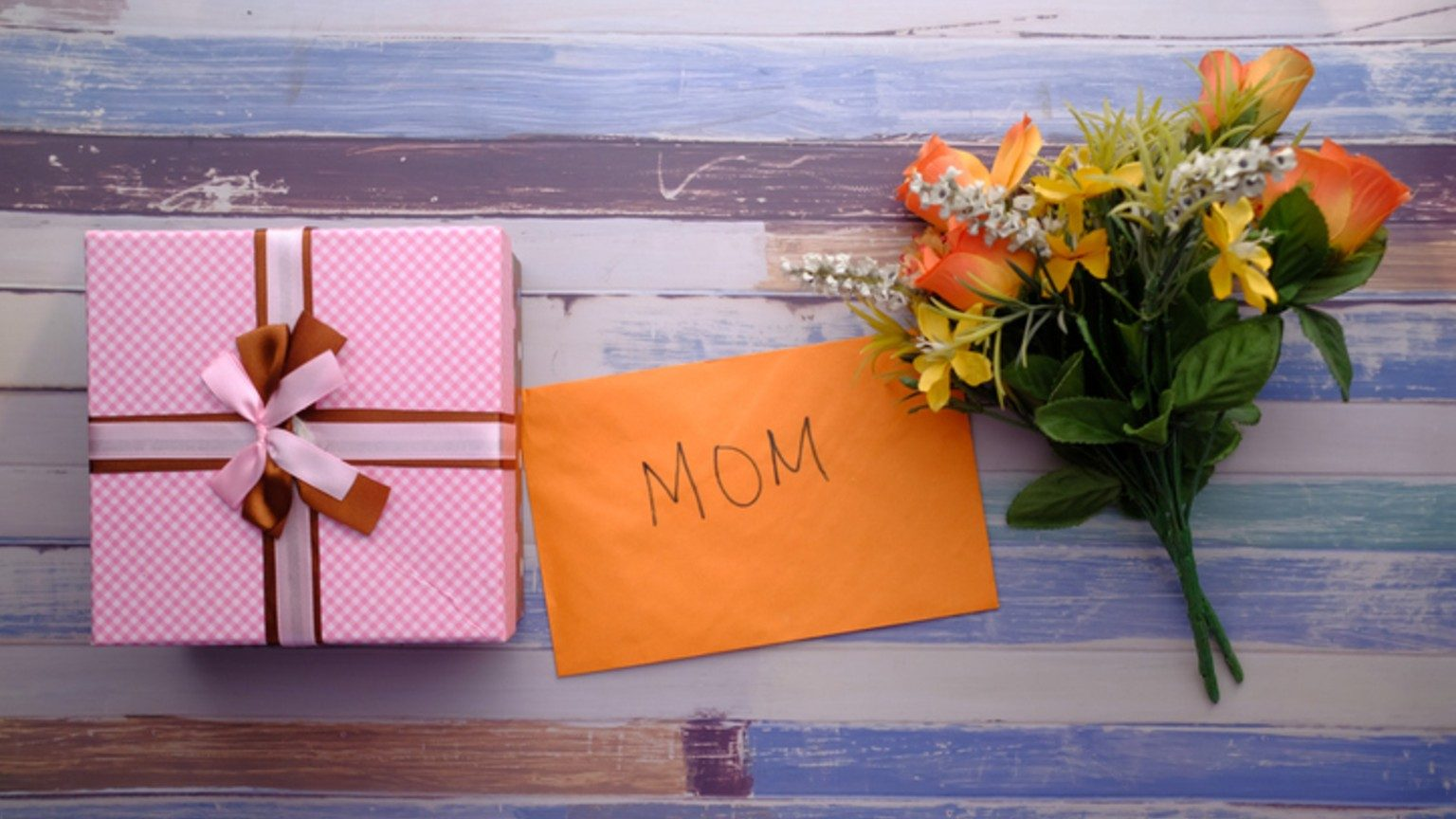 gift card and box on table with flowers
