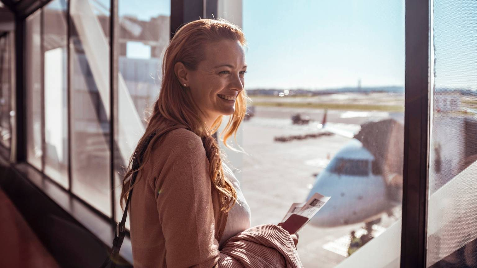 Young woman waiting to board the airplane