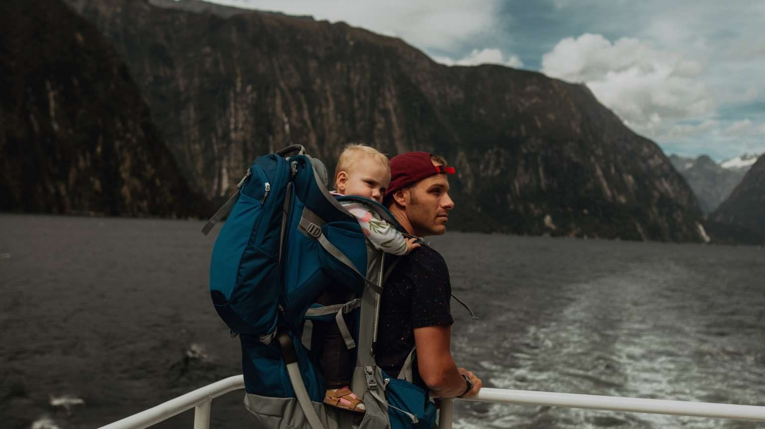 Man and his baby on a cruise with a view