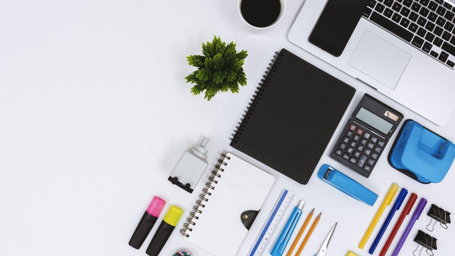 Office supplies in white desk