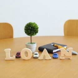 The word Loan in wooden material
