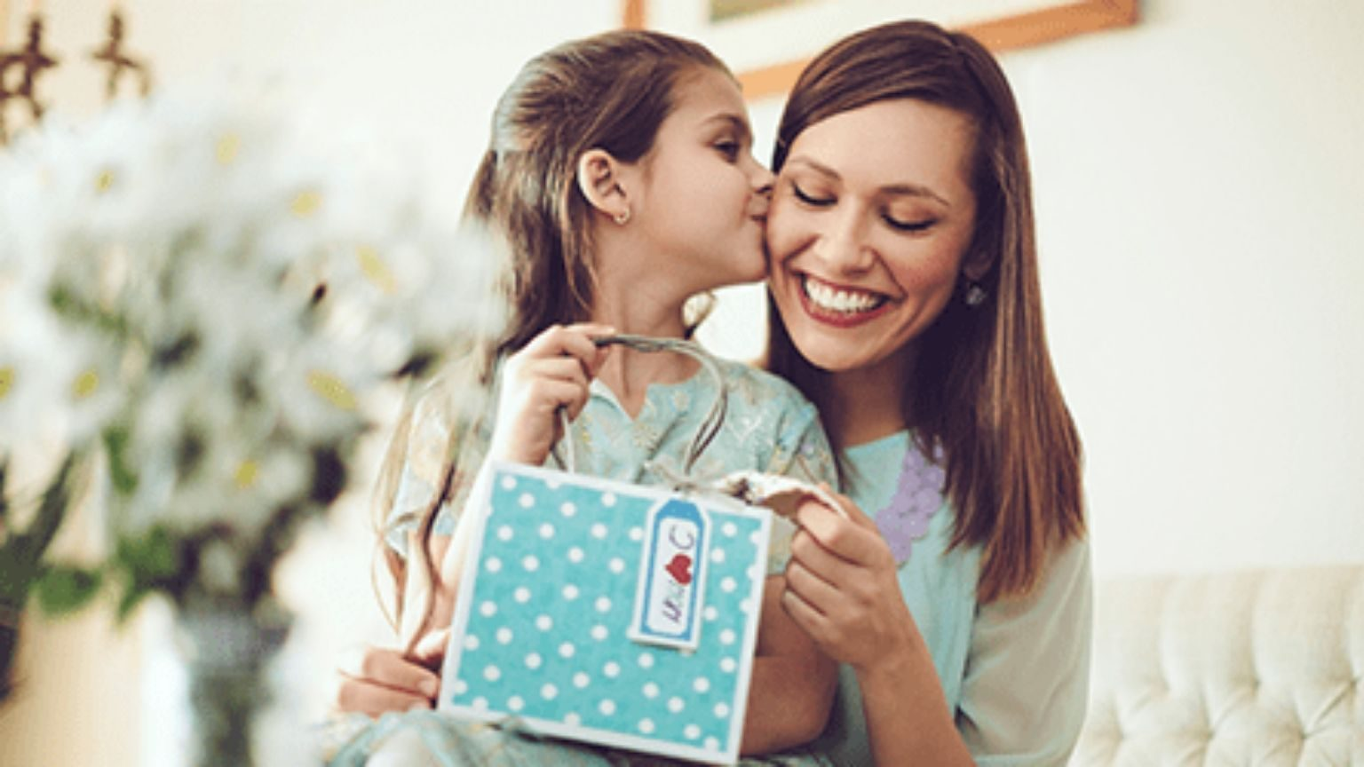 Daughter giving her mom a gift
