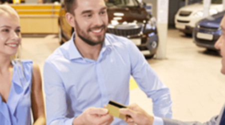 Can you buy a car with a credit card — and should you?