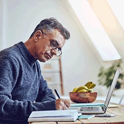 Senior man computing expenses