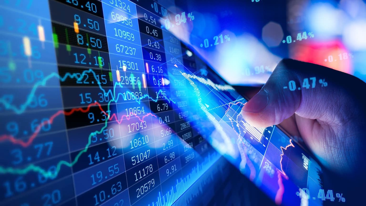 Close-up of hand using mobile phone and buying in stock market