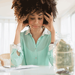 Stressed woman, paying bills