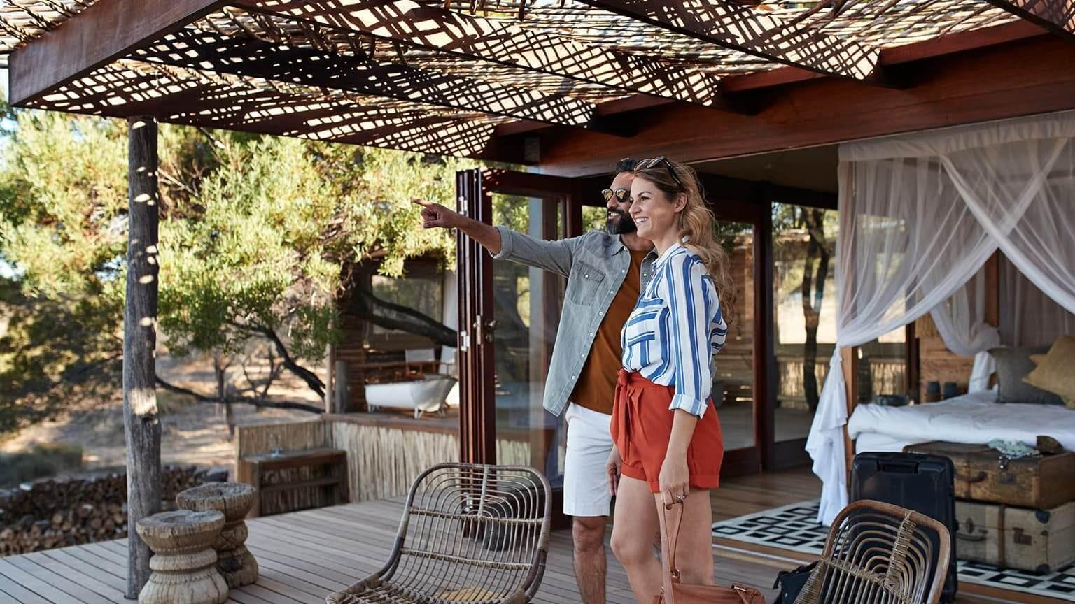 Couple having romantic getaway holiday in safari lodge