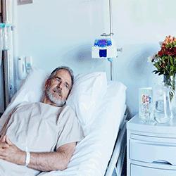 Worried man in hospital bed