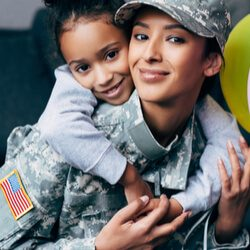 military woman with young child on her back