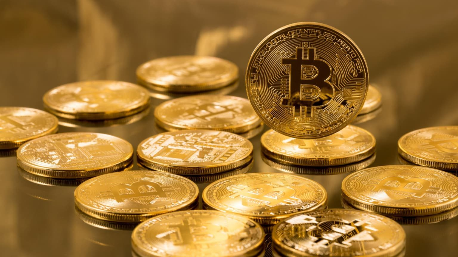 Gold Bitcoins on a table