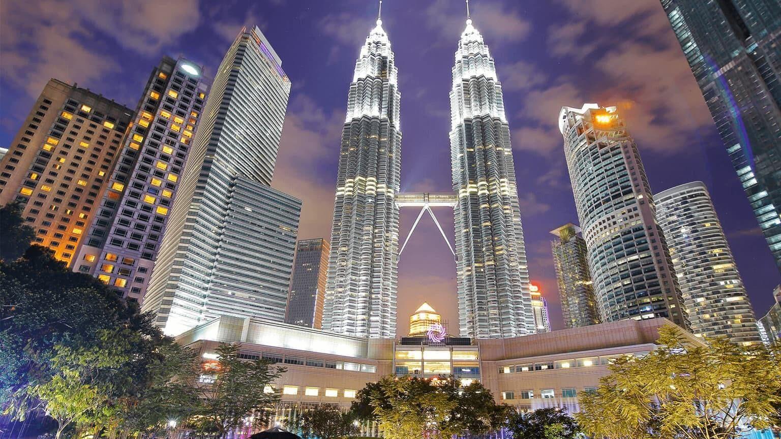 Petronas Towers glittering against nightsky