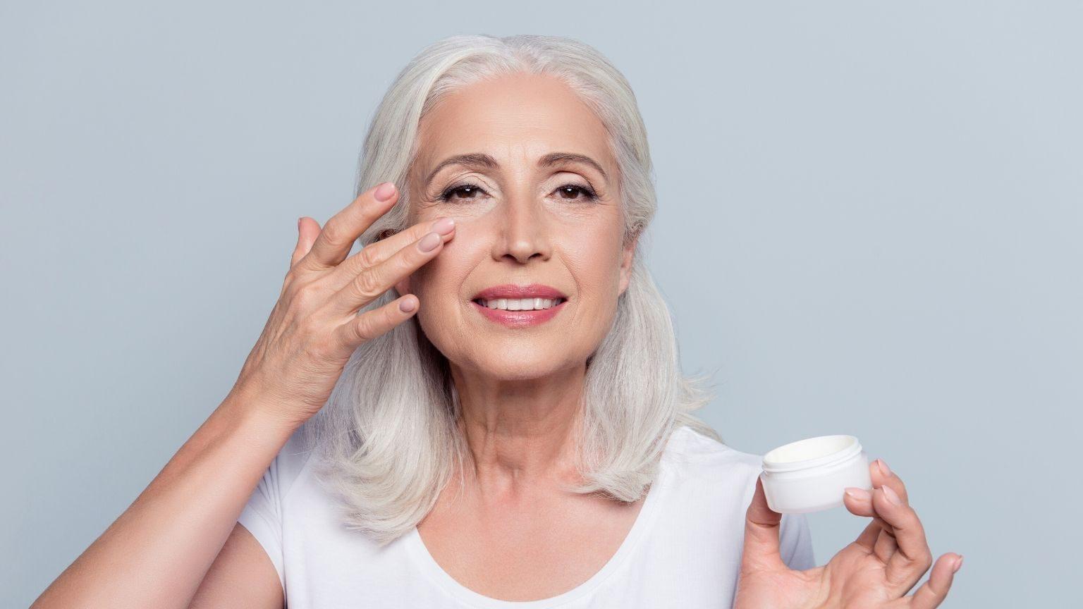 Woman using eye cream