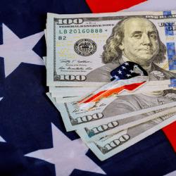 dollars and USA flag