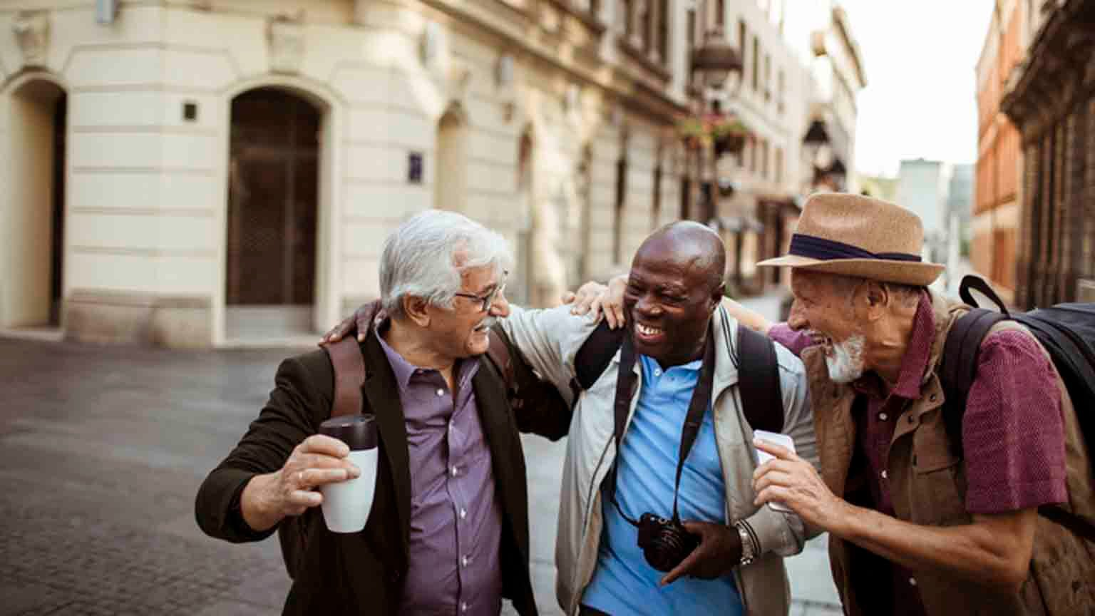 Close up of a group of male senior tourists exploring the city