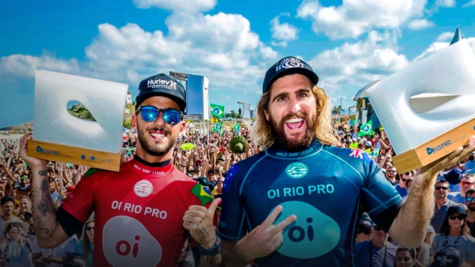 Two surfing champions in front of a crowd