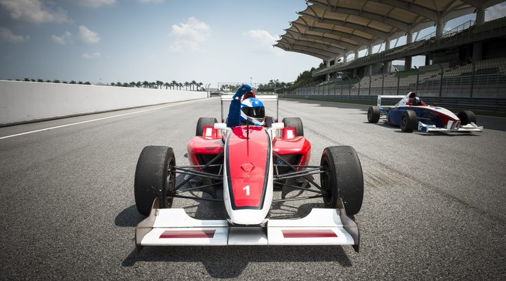 Red Formula 1 car on a race track