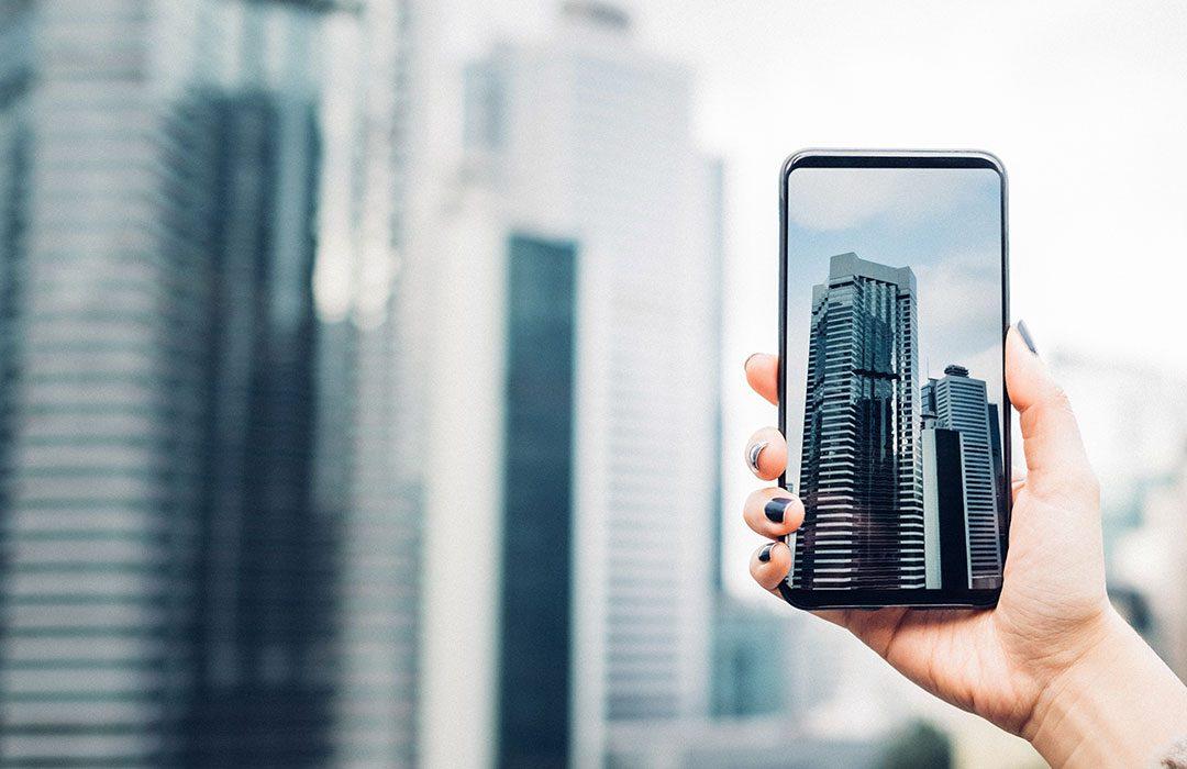 phone taking photo of skyline