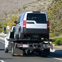 Car being towed.