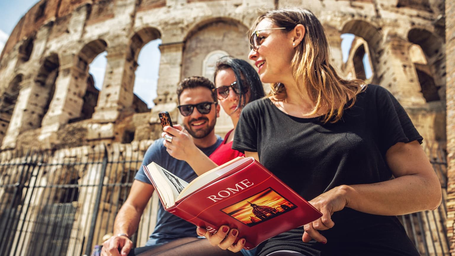 Tourists with tour guide in front of Coliseum