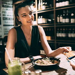 Woman paying her dinner with credit card