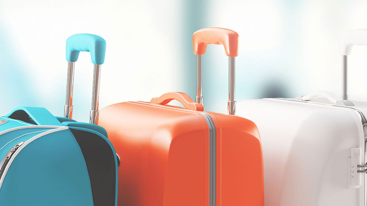 Close up shot of 3 colorful suitcases lined up