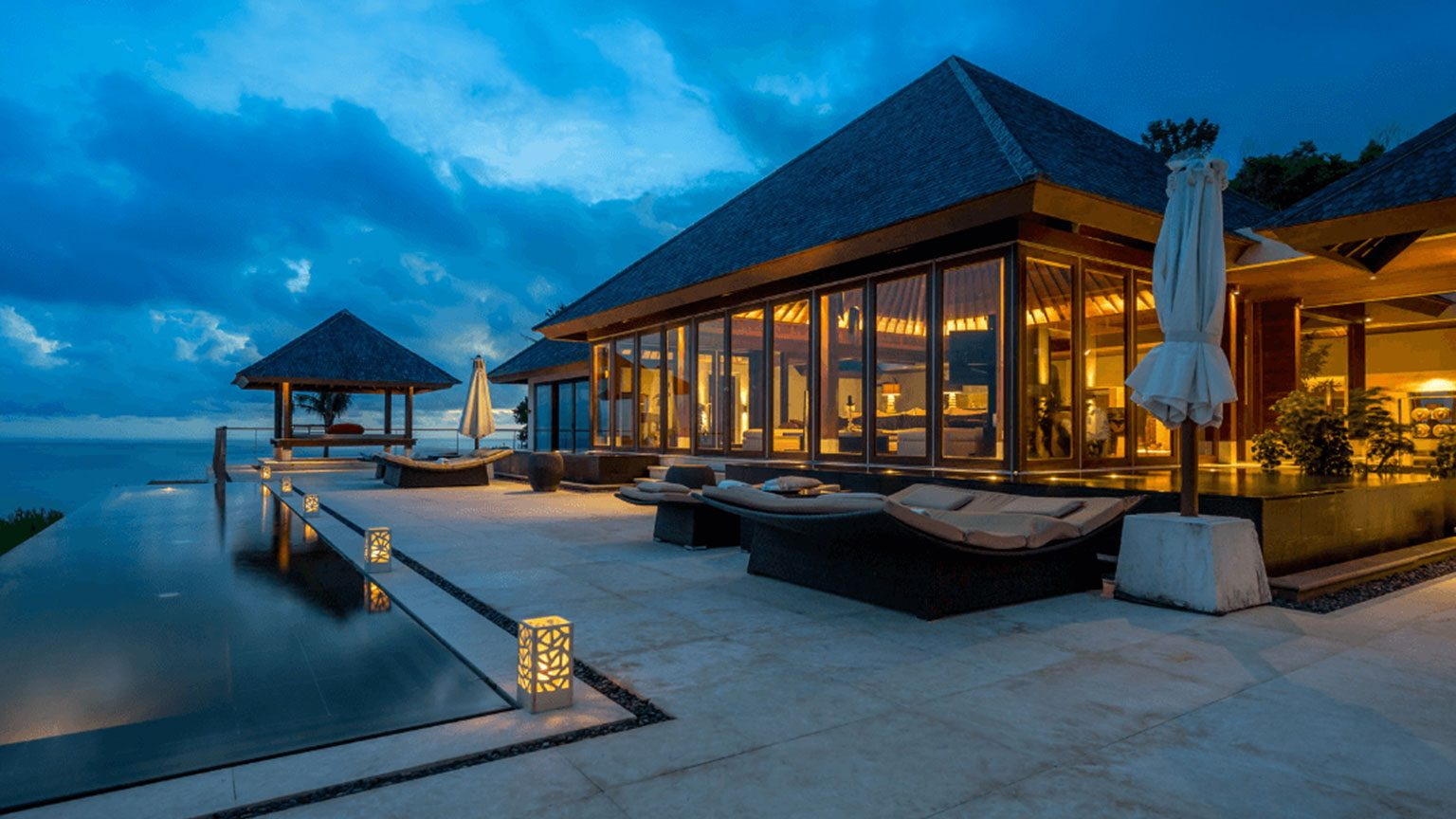 Luxury hotel villa with pool at night