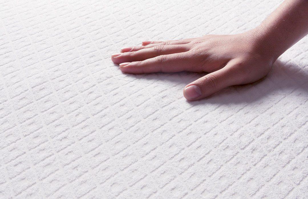 Female Hand Touching A Soft Mattress