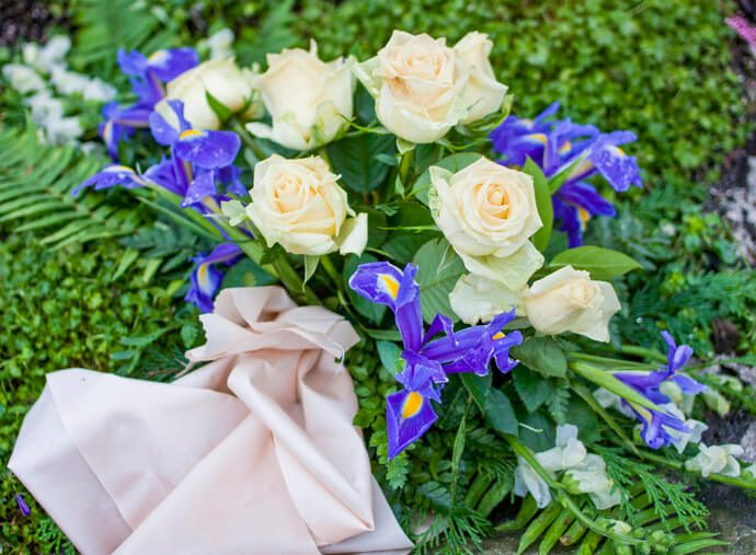 A bouquet of funeral roses and irises.