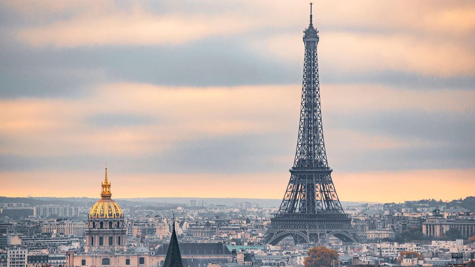 View of the Eiffel Tower and Paris city skyline at dusk
