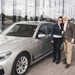 couple next to their brand new car