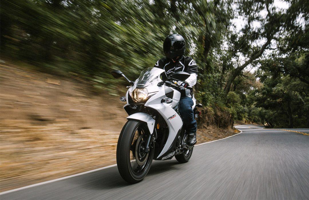 white suzuki on the road