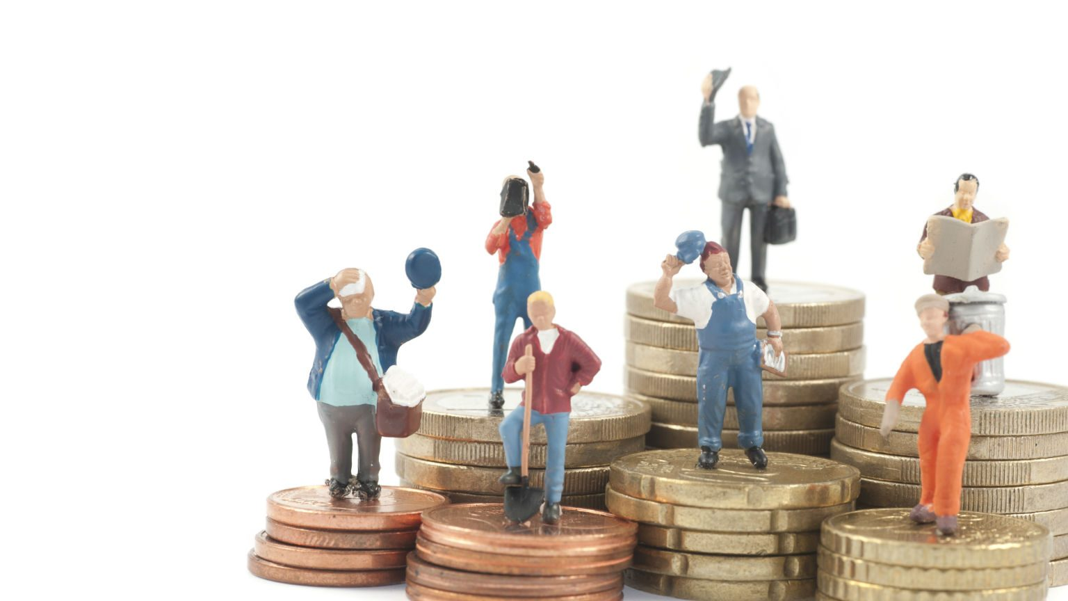 Worker figurines standing on coins.